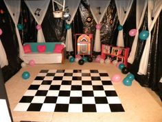 I bought a bunch of really ugly peel and stick linoleum tiles at Home Depot for a total of $14. The hubs helped me spray paint them black and white and then I attached them to some old flannel material that I had. Wha-la! A dance floor.