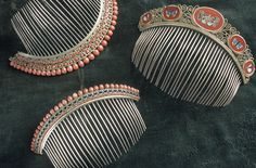 Coral empire diadem hair combs and a gold and micro mosaic butterfly hair comb, early nineteenth century