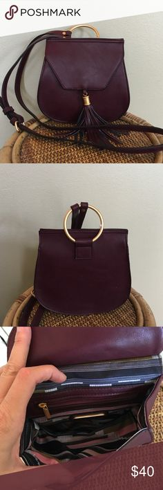 BIG BUDDHA CROSSBODY Brand new with tags.  Such a cute bag for the fall.  The color is Bordeaux.                                     Tassel accent Gold-tone hardware 7.25''H x 7.5''W x 3''D Approx. drop down strap length: 50'' Adjustable crossbody strap Magnetic snap closure Interior: zip pocket Faux leather🚫TRADES OR LOWBALL Big Buddha Bags Crossbody Bags