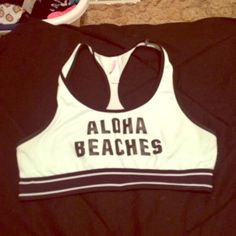 """Pink aloha beaches sports bra It's a limited edition pink sports bra . It's a size medium and is a little too big for me.  Super cute, says """"aloha beaches"""" on the front and pink nation on the back band. Comfortable fit. PINK Victoria's Secret Other"""