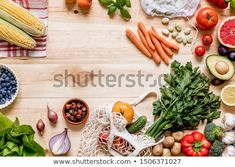 Stock Photo: Modern composition of fresh healthy vegetables and fruits on the wooden table in the kitchen. Healthy detox and balance diet. Healthy Detox, Healthy Vegetables, Medicinal Herbs, Balanced Diet, Wooden Tables, Top View, Zero Waste, Decoration, Bamboo Cutting Board