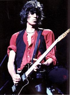 Keith Richards playing most likely in the 70's based on the haircut.