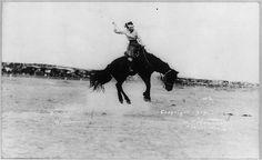 """Kitty Canutt"", champion lady horseback rider of the world, riding unbroken horse."