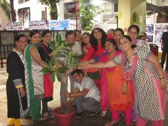 Teachers and staff at school for an Event of Tree plantation day.