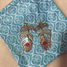 Kendra Scott earrings Kendra Scott feather earrings. Gold with fuchsia stones. No tags, bag is included. In great condition!  Kendra Scott Jewelry Earrings
