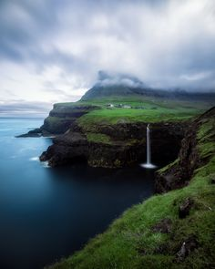 The Cliffs of Eysturoy and Bøssdalsfossur Falls, Gásadalur, Faroe Islands --- the Faroe Islands are, for their size, incredibly geographically diverse. Located almost dead center between Iceland, Norway, and Scotland in the northern Atlantic Ocean, they seem to compress a lot of the scenic best elements of each of those places, into just over 500 square miles spread across 18 islands. | by Conor MacNeill