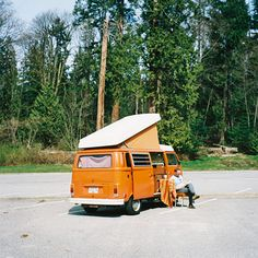 vw bus - and it's orange and it's just like my Barbie camper I had as a kid. Too cool.
