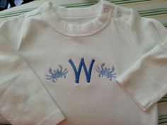 Embroidered initial with little blue crabs