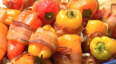 Mini Sweet Pepper Poppers  Ingredients:  1 bag mini sweet peppers  8 ounces fat free cream cheese  10 - 15 slices bacon  Toothpicks    Directions:  CUT a small slit in peppers and fill with cream cheese.  CUT bacon slices in half.  WRAP pepper with bacon and SECURE with toothpick. GRILL over indirect heat, turning occasionally for 10 – 15 minutes, or until bacon is cooked and peppers are lightly charred.