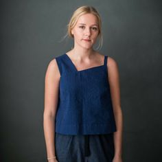 The Japanese inspired lines of the Gyo Top and Dress Sewing Pattern by Merchant and Mills make a neat and decisive asymmetric statement. This versatile style can be worn as an evening dress or as a cool and beautiful piece of summer wear.
