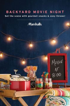 Create your own backyard movie night! Set the scene with glowing string lights, colorful candy and gourmet popcorn (we love these popcorn tubs!). Stack up cozy throws to make guests feel at home, and use a chalkboard sign to display your feature film. You'll find it all at Marshalls, priced to inspire.