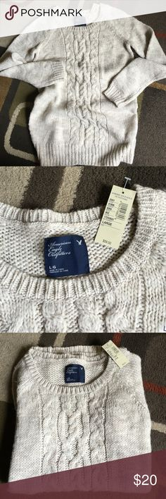 "American Eagle Outfitters sweater NWT material is 40% acrylic 30% wool 20% nylon 10% alpacalight Cream and beige coloring shoulder to bottom sweater is approx 28.5"" longlying flat measures approx 18.5"" across American Eagle Outfitters Sweaters Crew & Scoop Necks"