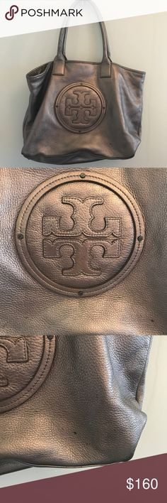 •Tory Burch• Silver Leather Purse Does have some spots. But they aren't super noticeable. Still in really good condition. Handles are almost perfect. Has a mirror made inside. Tory Burch Bags