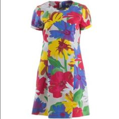 See by Chloe  floral dress This See by Chloe is amazing and the quality  amazing!!!! It features a zip up the back, 100% heavy weave cotton, gorgeous multi  floral print, round neck, short puff sleeves and unique kick panel in the front and back. This is one amazing dress. See by Chloe Dresses