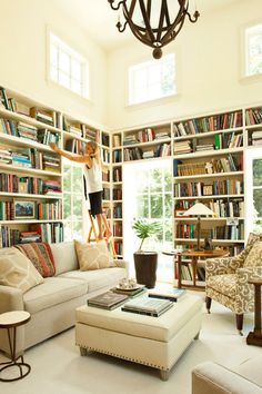 I want a room like this.. All those books and a comfy couch.. only thing missing is a cozy crochet blanket!