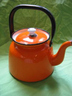 Bright Orange Vintage Enamel Tea Kettle ...would be so cute to set out for fall!