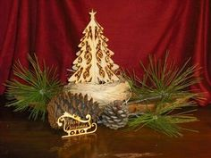 "Rustic Christmas table scape.   9"" Wooden Christmas tree $22 and laser engraved sleigh ornament."