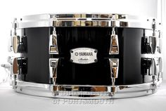 Yamaha Absolute Hybrid Snare Drum 14x6 Solid Black The new Absolute Hybrid Series inherits the hybrid shell technology found on our flagship PHX Series. On Absolute Hybrid shells, the design consists of a core ply of wenge a very hard and heavy wood native to Africa, sandwiched between plies of maple, well known for its clear tone. Purchase Here: http://www.drumcenternh.com/drums/snare-drums/yamaha-absolute-hybrid-snare-drum-14x6-solid-black.html