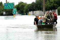 Residents are rescued from their homes surrounded by floodwaters from Tropical Storm Harvey on Sunday, Aug. in Houston, Texas. (David J. Texas Coast, Weather Warnings, Shark Swimming, The Weather Channel, News Media, Dodgers, Mlb, Houston, Bring It On