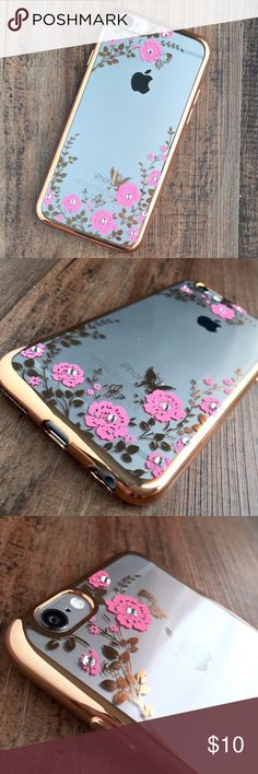 iPhone 6 Plus floral case - gold with pink flowers This charming case features a TPU material, the border is a mirror type material with either gold coloring, and has a printed floral pattern with gems in the middle of the flowers! The clear back shows off the awesome design of the iPhone while making it unique compared to all other iPhones and cases. The buttons are easily pressed and the silence switch is easily accessible. Check out our profile for the other options and all of our…