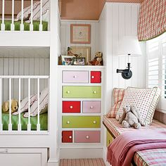 The kids' bunk room features a lively mix of coral, pink, and chartreuse on the built-in beds, painted chest, and plush window seat.