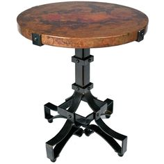 $849 Pictured here is the Iron Rivet Strap Accent Table with Wrought iron base and Hammered Copper Table Top