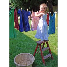 mama's little helper #laundry #clothes on the line @http://www.soulemama.com/soulemama/2008/08/days-of-summe-3.html