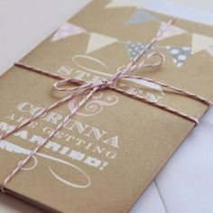 Bunting, brown paper, and twine. What more could you want in an invitation