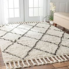 Inspired from Morocco, this reversible hand-knotted trellis shag rug is made of 100-percent wool. Both ends contain hand-braided tassels and a soft and plush pile, make your space feel right at home. The half-inch pile on this gorgeous carpet makes it ideal for barefoot enjoyment and gives your room a relaxed casual feel.