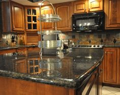 Marvelous Uba Tuba Granite Countertop And Slate Tile Backsplash Idea   Eclectic    Kitchen   Indianapolis   By Supreme Surface, Inc. Nice Ideas