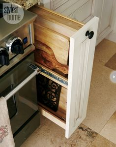 Small drawers can be handy  A small cupboard doesn't have to be ignored or used as a junk drawer. Use it to house cutting boards or baking trays.