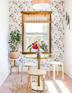 Kitchen dining space with colourful floral wallpaper