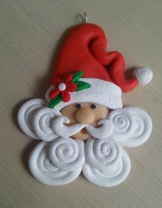 This handcrafted polymer clay whimsical santa ornament was carefully crafted with a keen attention to detail and made with love.  The item