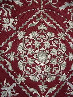 Absolutely beautiful red, taupe and cream quilt.