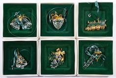 """Lot 355: Swarovski Crystal """"Memories"""" Ornament Assortment; Six ornaments including a candy cane, Christmas tree, train, bells, pine cone and holly"""