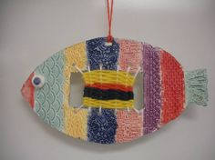 This is a clay fish with a weaving inside.  My Art club did a clay sculpture full of texture, glazed it in their choice of color and did a patterned weaving inside. Isn't it wonderful?!