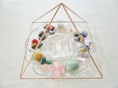 Crystals Charging under a Copper Pyramid