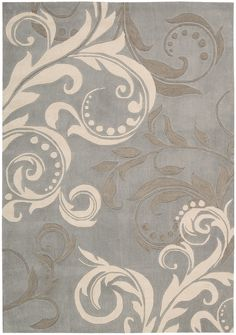 Nourison's Contour rug offers a luminous silvery-blue background gets an infusion of energy from an oversized scrolling leaf and vine design rendered in super chic shades of white and slate. This contemporary rug's exquisitely hand-carved details are sure to make you step out of your shoes.