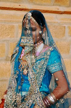 Rajasthani Beautiful dressed in their cultural attire... but if it fell off my head, I'd leave it off.