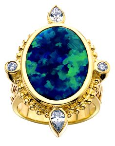 "Paula Crevoshay ""Black Beauty"" ring in yellow gold, set with a 9.96ct black opal from Lightning Ridge."