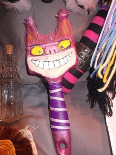 cheshire cat altered paint brush i made for a swap! the flash made the pink in the ears not show up and it is a lil bit blurry but you get the idea! made by artista83-amanda rybarz