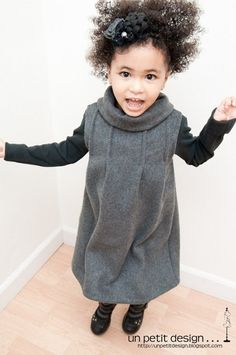 Darling Jennifer at Un Petit Design has provided a FREE pattern inspired by the cozy Little Grey Dress we've all seen pinned here.  She's provided both a sleeveless jumper version as well as one with sleeves. Doesn't her little girl look happy in the dress her mommy made?