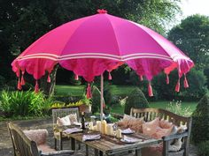 Inject some colour into your garden with a bright and funky flamboyant garden parasol