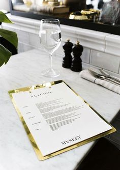 Love the details like this brass backed menu and a cognac banquette in Swedish/French Restaurant Museet in Stockholm