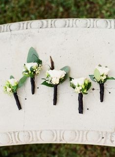 White rose boutonnieres with berries | photography by http://katiestoops.com/