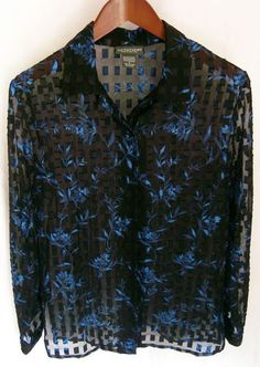 This is a gently worn Notations blue black abstract floral casual evening long sleeve S Women's Top. This top looks brand new. The fabric is sheer black with an electric blue floral print. There are little black satin squares. There are seven black buttons up the front and one on each cuff. This top was meant to be worn over another top. It is extremely eye catching, yet subtle. This top is absolutely beautiful. Whoever wears it will receive many compliments.