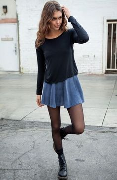 Street fashion blue skirt, tights and boots