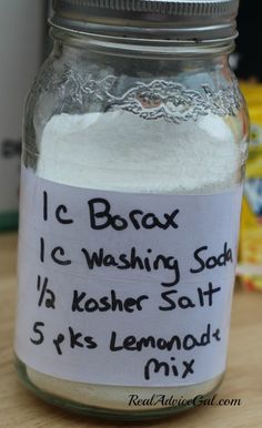 homemade dishwasher detergent in a mason jar labeled with ingredients