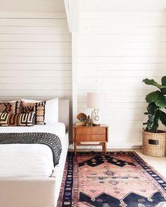 white shiplap + colorful rug