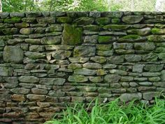 A stone wall creates a timeless garden border and adds charm and character to the garden.